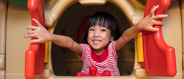 Young girl in a playhouse window