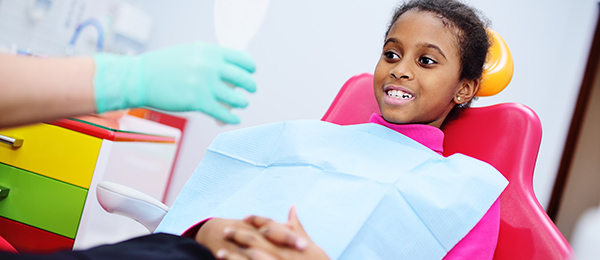 Smiling girl in dentist chair
